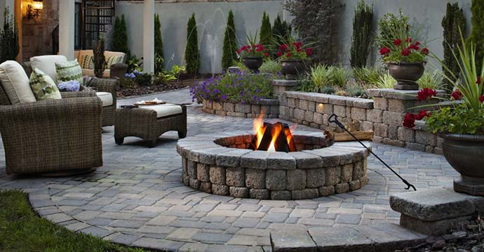 Custom patio, retaining wall, and fire pit that was designed and built for a homeowner in Lakeland, FL.