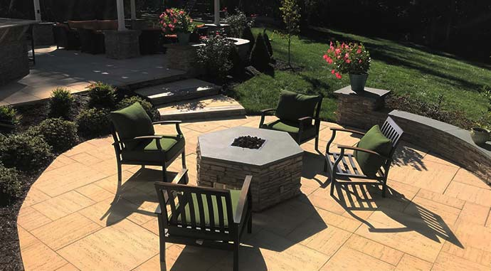 Custom patio with a fire pit featured at its center.