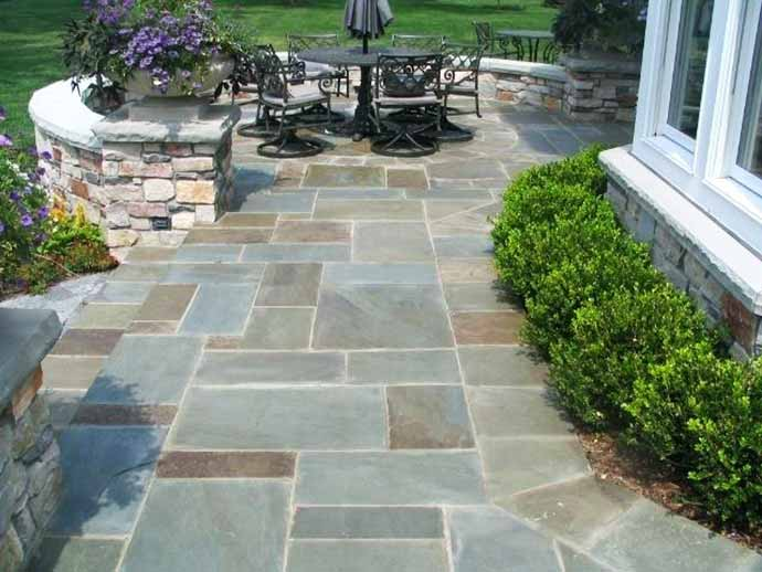 Our team designed and built this Lakeland homeowner's paver patio and stone wall.