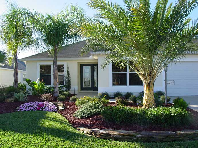 Home with a small front yard that receives landscape maintenance services.
