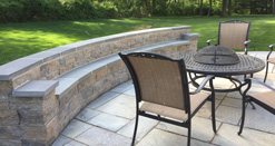 Hardscaping services include custom patios, retaining walls, and more.